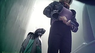 Pale skin blonde lady in the public toilet room recorded on spycam