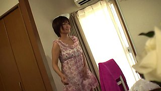 Shaved Japanese housewife gets her pussy toyed at home