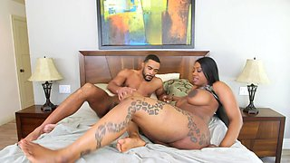 A huge ass black chick is getting fucked and cumshot on the bed