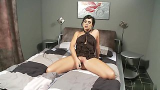 Stunning brunette masturbates with a dildo in bed
