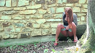 Cute and fresh amateur babe squats and pisses in the park