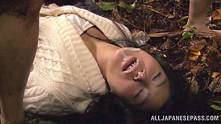 Horny Asian hottie gets her hairy pussy drilled outdoor by two cocks