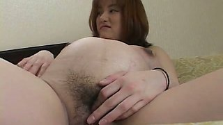 Perverted Japanese sinful lady pets her hairy cunt with pink toy