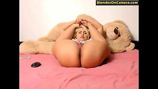 Flexible blonde slut masturbates her pussy