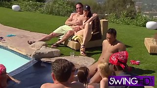 insatiable swingers are hammering each other in the pool