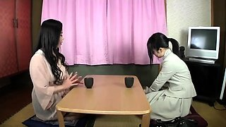 Asian girl fingered fucking busty girl with strapon in the b