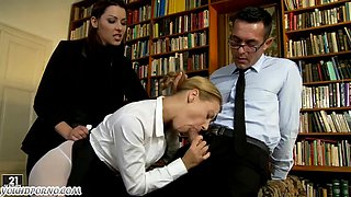 The teacher punishes teen pupil in the school library