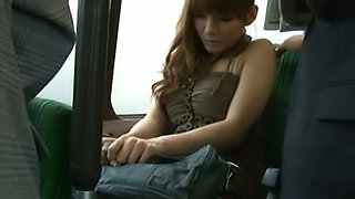 She is on the bus with her friend and wants to be naughty