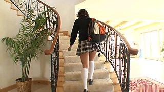 Pretty 19yearold brunette, Bella Rey, wearing a Catholic schoolgirls uniform, gives a man