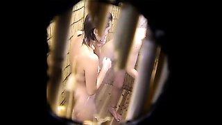 Horny voyeur finds a sexy slim brunette taking a shower