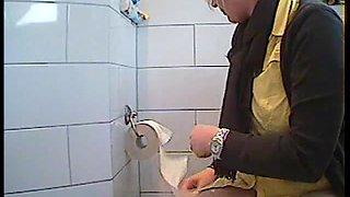 Woman being caught on hidden camera in bathroom
