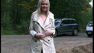 Stunning skinny blonde Russian girl in coat flashes her goodies on the street