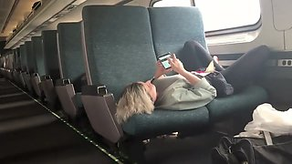 Hot babe spreads across two seats