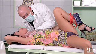 Perverted doctor fucks throat and examines anal hole of one busty tied up brunette
