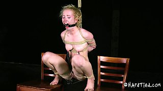 Tied up slut with small tits is punished with nipples clamps
