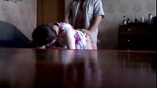 Hidden cam showing a Russian unfaithful wife fucked doggystile by her lover.