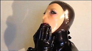 Slave Girl giving full latex blowjob