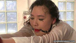 Submissive gagged Jap slut Aki Sasahara has to drink urine of studs