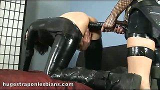 Lesbians having hot strapon sex