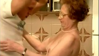 Willing granny sucks hard dick of hot guy in her kitchen