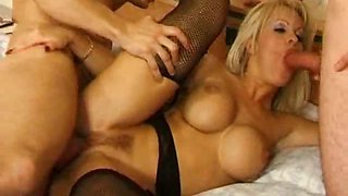 Huge breasted blonde whore in stockings gets fucked by two
