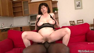 This granny has a huge pair of tits and she loves fucking black men
