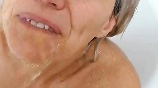 SabinaAgos takes a bath, but her husband needs an urgent piss