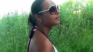 A lovely amateur couple is walking through the forest and goofing around