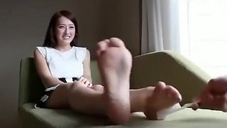 Tickling pretty Chinese girls feet