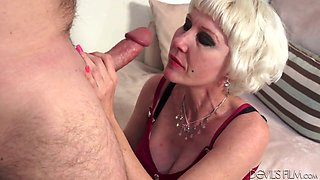 Old slut Dalny Marga guzzles juicy cock standing on knees