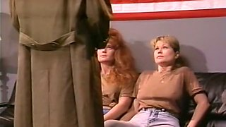 A blonde and a redhead show their blowjob skills in retro video
