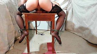 Crossdresser bondage table trying