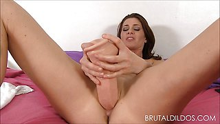 Cici Rhodes punishes her pink pussy with big dildos