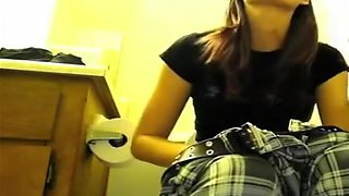 Girl lifts toilet seat and pisses