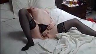 Ravishing redhead broad in stockings plays with her puffy clitoris