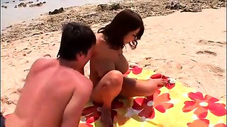 Big breasted Japanese babe takes a hard fucking on the beach