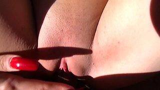 Bikini girl fingers pussy to tease the boy