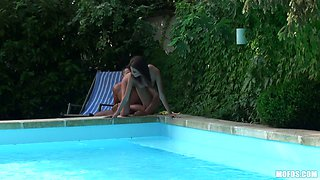 Mad slim nympho Denisa Doll rides a cock on the deck chair near the pool