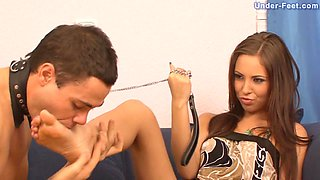 Arousing mistress smokes a cigarette while sitting on slave's body
