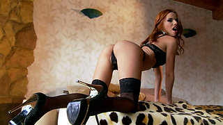 Fiery redhead in seductive lingerie gets her anus stretched out nicely