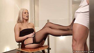 Sensual lady Blanche Bradburry gives a footjob in her super sexy stockings