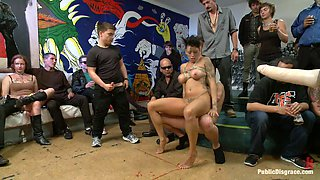 Busty whore tied up and abused in public bondage scene