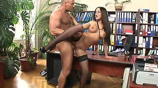Smoking hot brunette with glasses rides her boss in his office