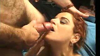Italian MILF enjoys a bukkake gangbang