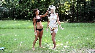 Two sexy girls in tight bikinis have fun in the outdoors