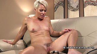 blonde mature lady bangs machine on the sofa