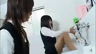 Asian schoolgirls are having fun in man's toilet
