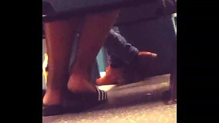 Feet flashing spy in bus