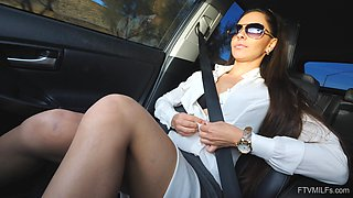 Horny brunette teen Milana masturbates and strips in a car