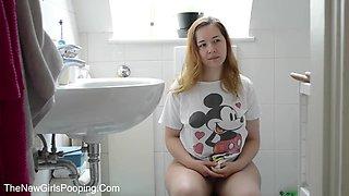Teen in toilet
